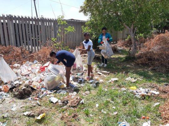 Cleanup of dumpsite to establish a garden