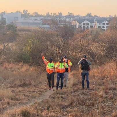 Residents inspecting the area after cleanup