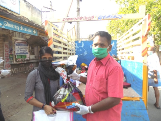 A Beneficiary is receiving Groceries Kit