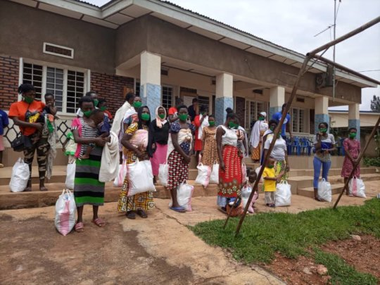 Ndera locals at food aid collection point near CM
