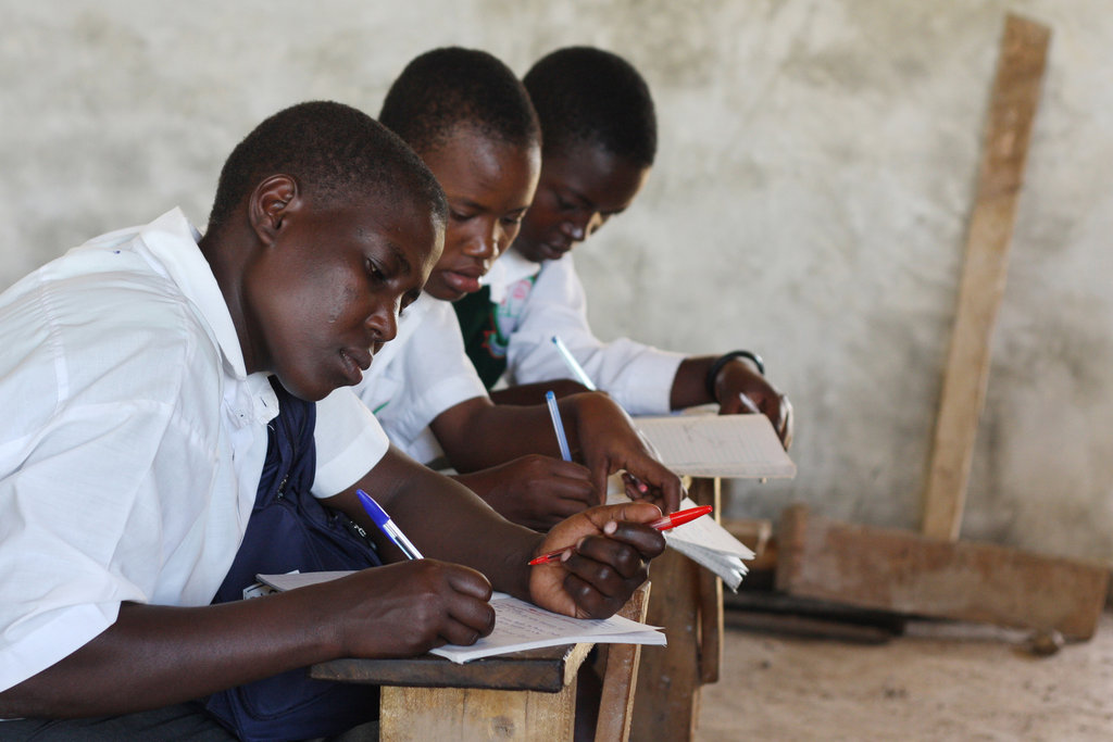 """Here are three of our Kenyan students working inside the classroom. In our pioneering educational model, students pair traditional academic learning with a """"""""Learning By Doing"""""""" technique.  So when they graduate, they will have the skills to raise themselves out of poverty."""