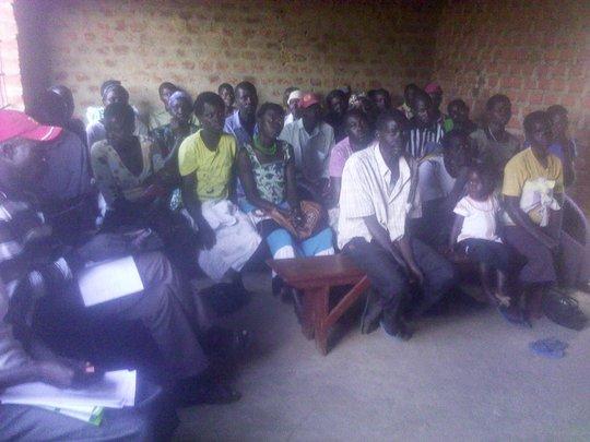 The community listening to the facilitator
