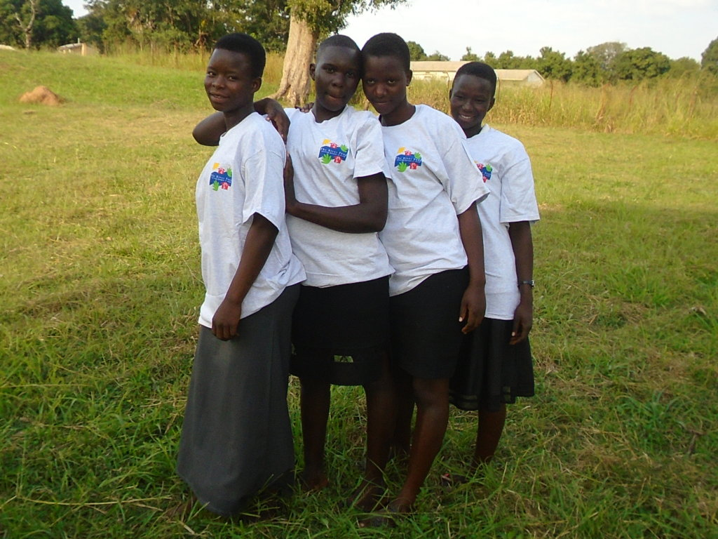 Students pose for a photo after receiving T-shirts