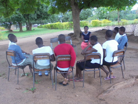 A mentoring meeting with beneficiaries.