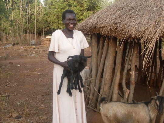 Group member with baby goat