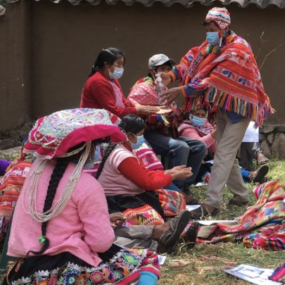 Llama farmers practicing hand disinfection steps.