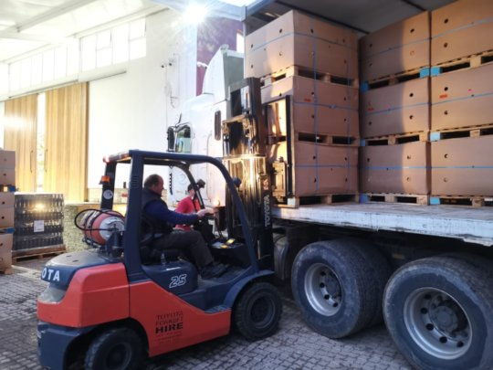 Unloading 32 tons of apples from Graaff fruit