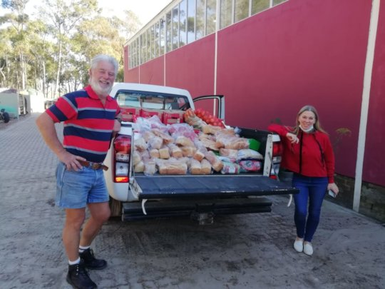 Rotary Club of Stanford collecting food relief