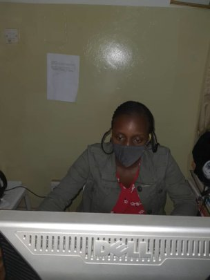 Sheilla Working on an administrative report
