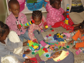 Annan and other children playing with toys