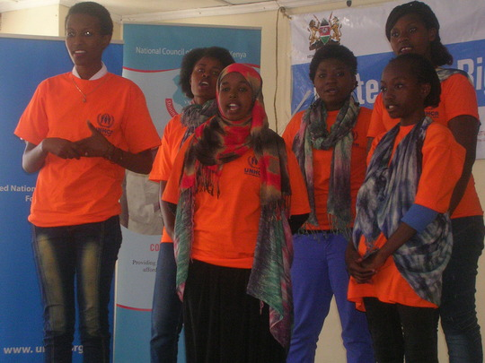 Sumaya reciting a poem during 16 days of activism.