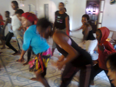 The girls smiling and dancing during Zumba class