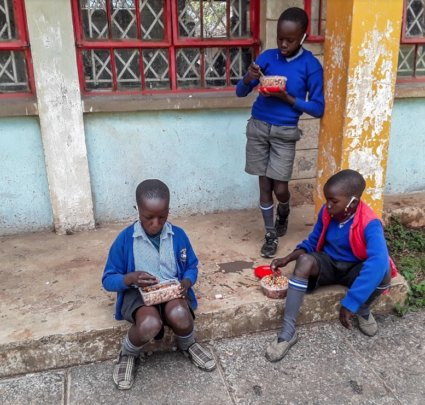 Gatoto students enjoy a meal