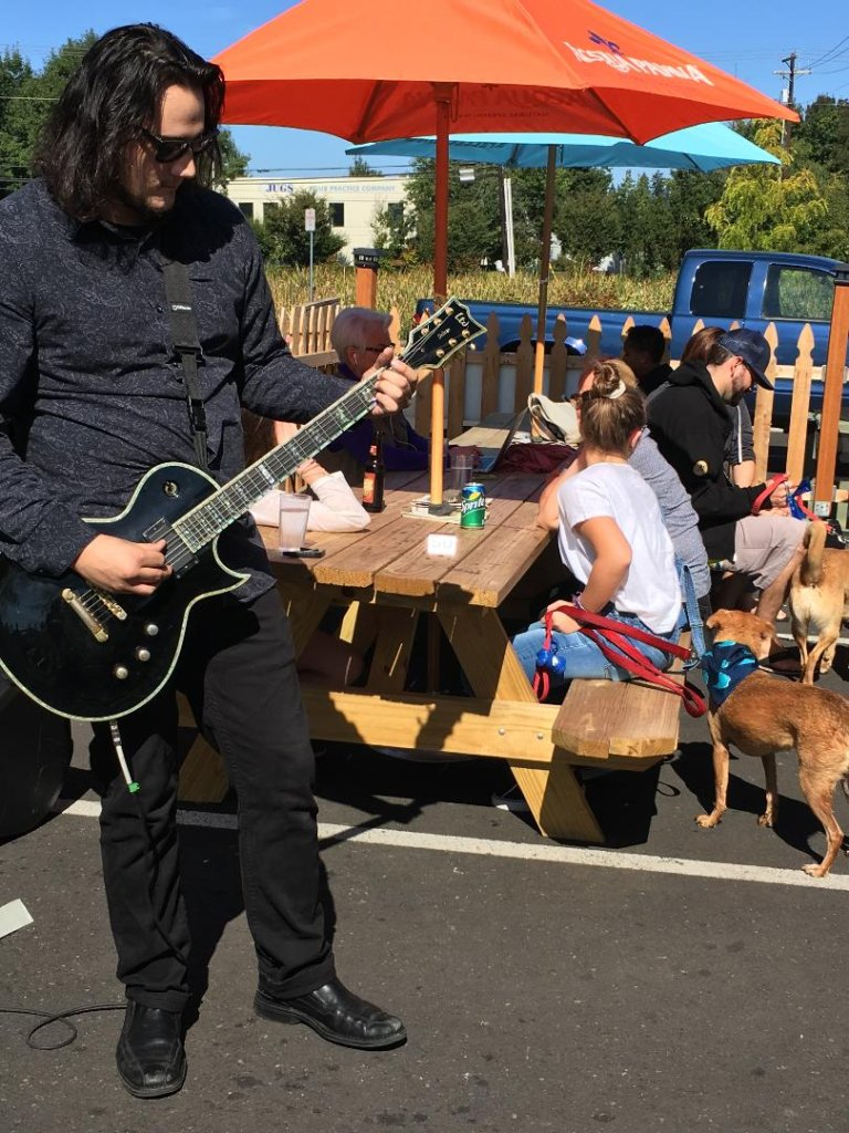 Jeff playing guitar at the annual dog wash