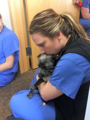 Sam comforts a hospital employee