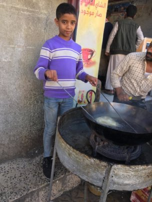 Asem - children working to feed his family