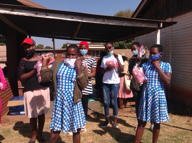 Girls receiving dignity packs