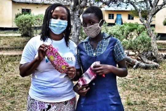 Panashe receiving her reusable sanitary pads...