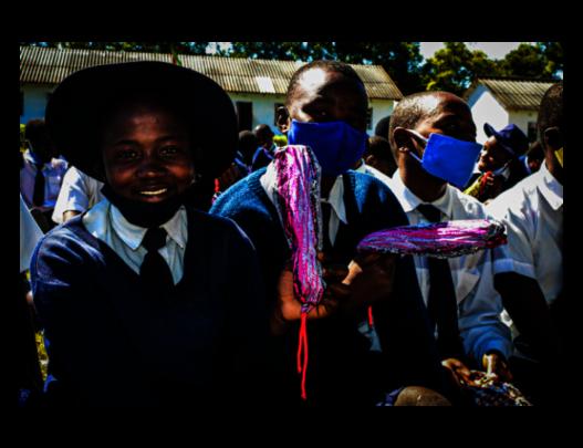 School girls receiving reusable cloth pads.