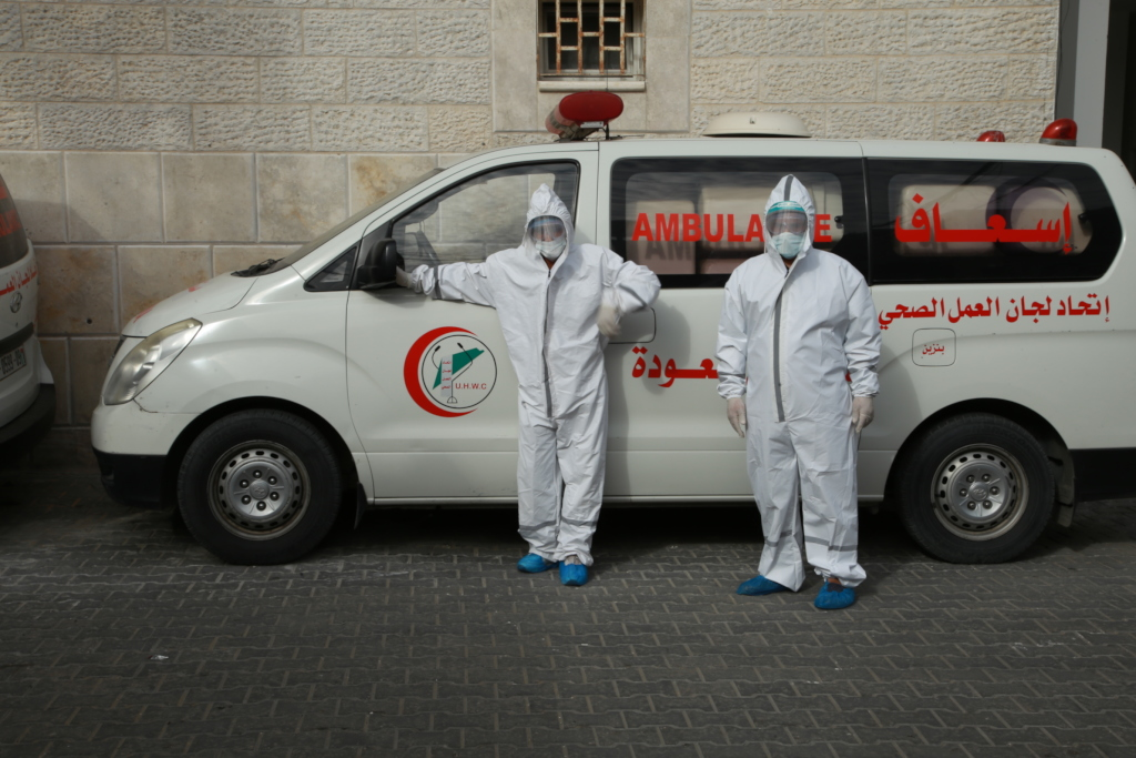 Al Awda Hospital crews with PPE