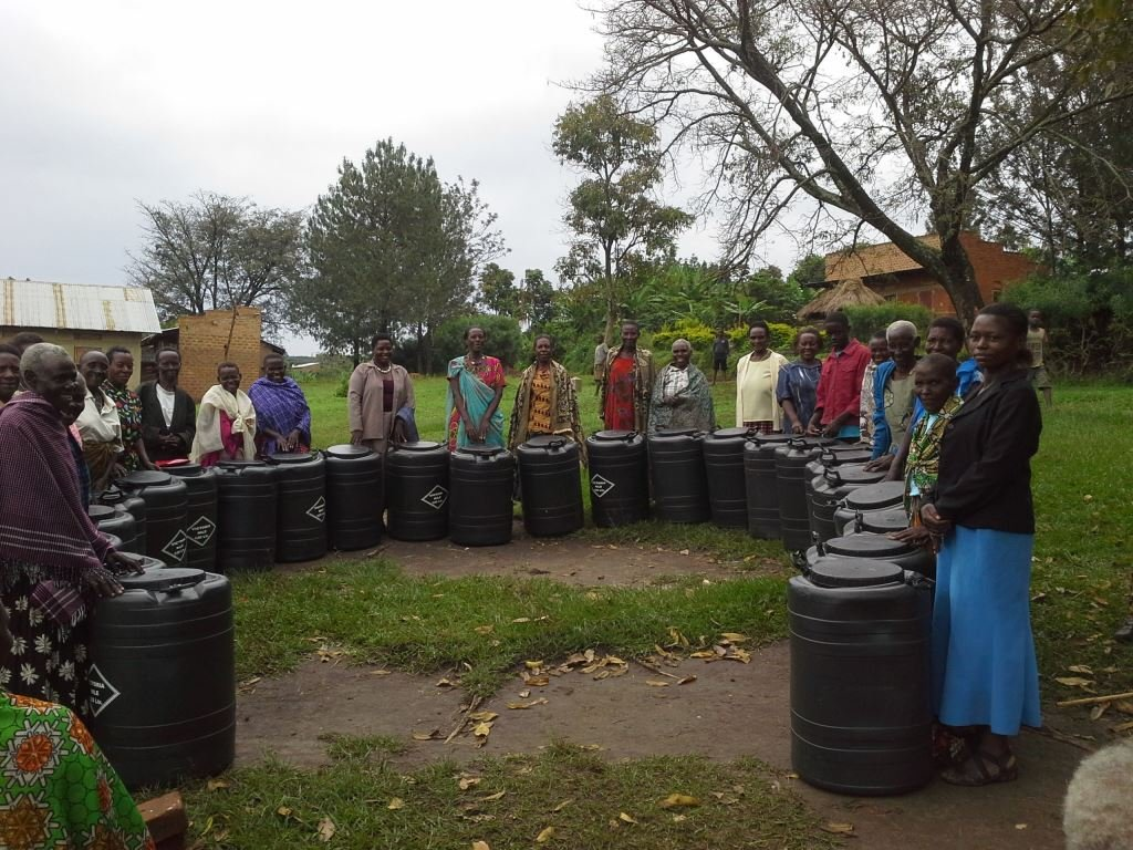 Grandmothers with water harvesting tanks