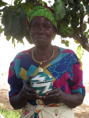 Grandmother holding a basket she made