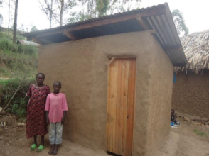 Florence and Marvin with their new pit latrine