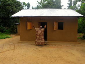 Furida dancing in front of her new home