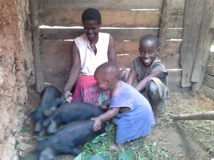Jane, Timothy, Joel and their piglets