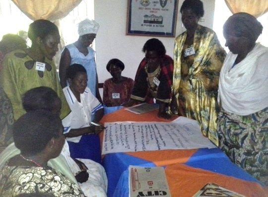 Grandmothers brainstorming during TOT workshop.