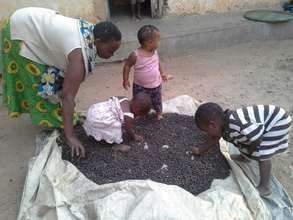 Enid drying her coffee with her grandchildren