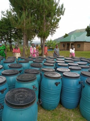 Grandmothers Receiving Water Harvesting Tanks