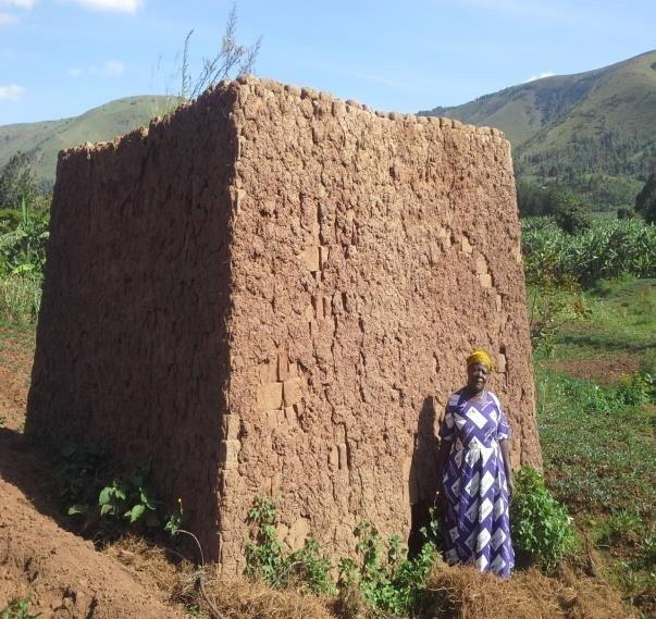 Veneranda in front of her kiln of bricks