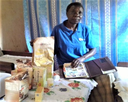 Provia displaying the products she sells