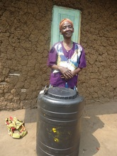 Rosa with her water harvesting tank