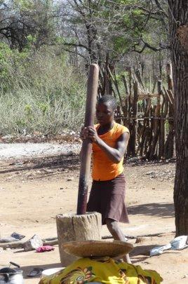 Shangaan woman pounding maize