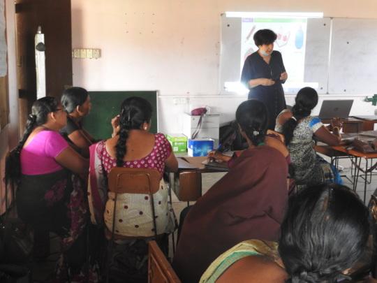 Teachers participate in training session