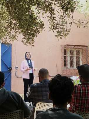 Kawtar assists the GLCs with a Community Dialogue