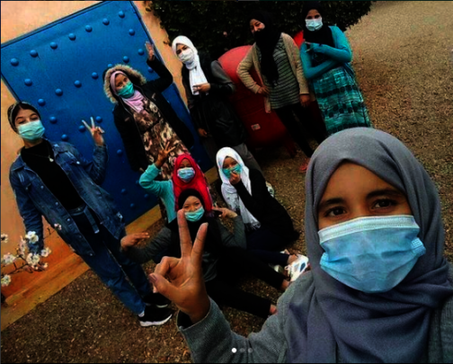 Khadija poses with Project Soar girls.