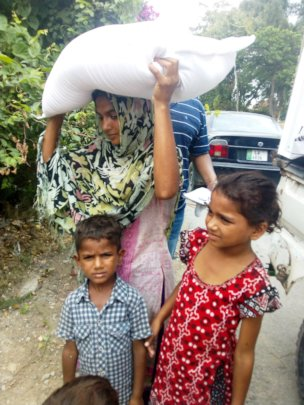 Flour bag receive by single mother for children