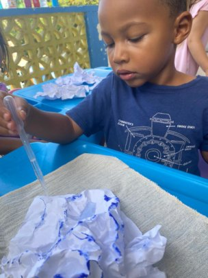 Child engages in Paper Mountains activity DKIII