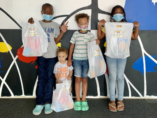 Kids receive discovery kits at the VICM