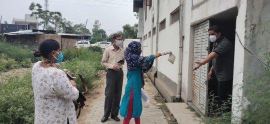 ASHA workers disturbuting COVID-19 medicine kits