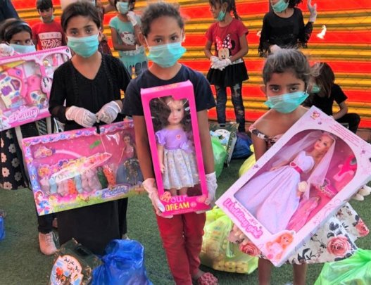 3 girls get dolls as a special treat during COVID