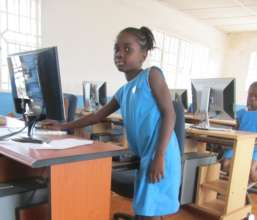 Jeminatu at her computer
