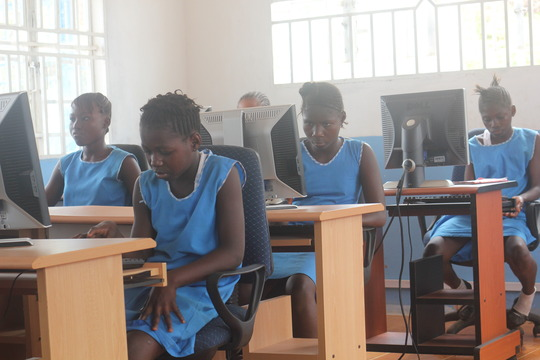 girls learning in computer lab
