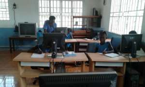 Girls learning at the FAWE lab