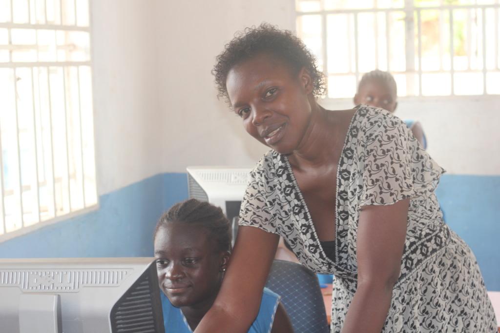 Teacher coaching a student - hands on