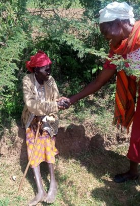 Elderly grandmother recieving a helping hand