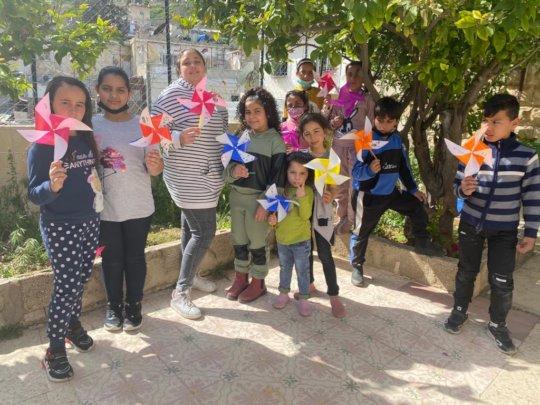 Madaa Creative Center children make pinwheels